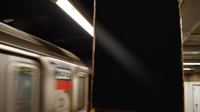 Blank Sign and Manhattan Subway Leaves the Platform. 8721 A Manhattan subway train leaves the platform. Blank sign on pillar for customization stock footage