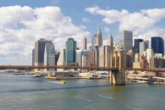 Manhattan at sunny day. Manhattan skyline with Brooklyn Bridge at sunny day Royalty Free Stock Photo