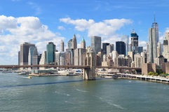 Manhattan at sunny day. Manhattan skyline with Brooklyn Bridge at sunny day Royalty Free Stock Images