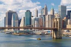 Manhattan at sunny day. Manhattan skyline with Brooklyn Bridge at sunny day Royalty Free Stock Photography