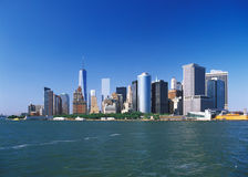 Manhattan on a sunny day. View of the Manhattan Island on a sunny day from the Staten Island Ferry Stock Image