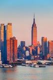 Manhattan at sunset Stock Photos