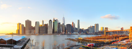 Manhattan Sunset Panorama, New York City. A panoramic view of lower Manhattan and Brooklyn Bridge as the sun sets on New York City royalty free stock photography