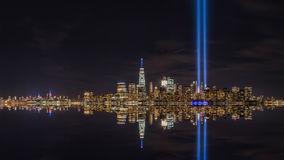 Manhattan Tribute In Light Reflections. A beautiful panorama of Manhattan during September 11th Tribute in Light ceremony Royalty Free Stock Image