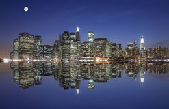 Manhattan under the moonlight. Manhattan and reflection under the moonlight Stock Photo