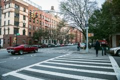 Manhattan uptown intersection with light, cars and crosswalk Stock Photos