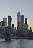 Manhattan. View of Manhattan skyline with Brooklyn Bridge at sunset Stock Photos
