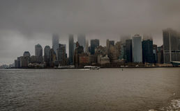 Manhattan from the water on the cloudy day Stock Images