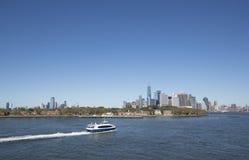 Manhatten skyline New York City. View of Manhatten skyline New York City with a boat passing Stock Photos