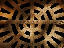 Manhole. A manhole cover in shadows Royalty Free Stock Images