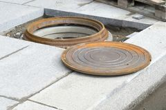 Manhole close-up during the construction of communications of the building. Background stock photos