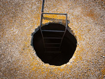 Manhole in concrette wall with stairway do down Royalty Free Stock Images