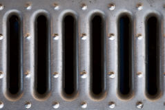 A manhole cover. Steel grate in the background Stock Photo