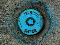 Manhole Cover. This blue Trumbull Water manhole cover was discovered in Providence, Rhode Island Royalty Free Stock Photos