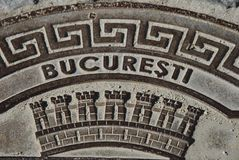 Manhole cover in Bucharest, Romania Royalty Free Stock Images