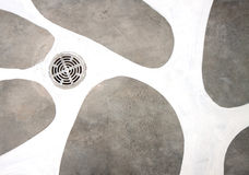 A manhole cover on cement background Stock Images