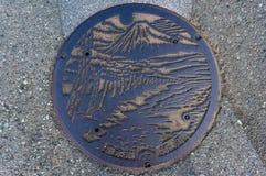 Manhole cover design in Shizuoka, Japan. Shizuoka, Japan - September 3, 2016: Manhole cover design in Shizuoka. Japanese manhole covers come in a variety of stock photos