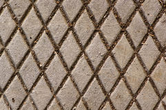 Manhole cover with diamond pattern Stock Image