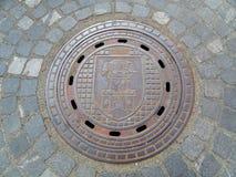 Manhole Cover found on the cobblestone path in Ljubljana of Slovenia Stock Photography