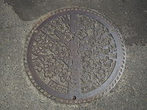 Manhole cover in Funaoka, Japan. Royalty Free Stock Photography