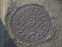 Manhole cover in Ōgawara, Japan. Stock Images