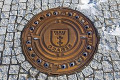 Manhole cover with Gdansk emblem. Gdansk, Pomerania, Poland Royalty Free Stock Images