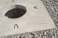 Manhole without cover in new concrete block Royalty Free Stock Images