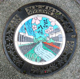 Manhole cover, Omi-Hachiman, Japan Stock Photos