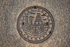 Manhole cover at Osaka Castle, Japan. Osaka, Japan  May 5, 2015: beautiful manhole cover at Osaka Castle, Japan Stock Photos