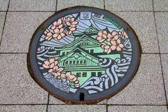 Manhole cover, Osaka royalty free stock images