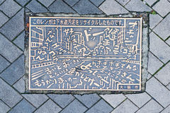 A manhole cover in Osaka, Japan Royalty Free Stock Images