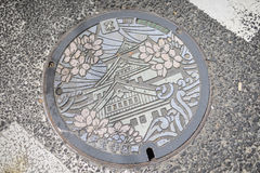 Manhole cover. Osaka, Japan - May 6, 2015: Manhole cover at Shitennoji Temple, Japan Royalty Free Stock Photo