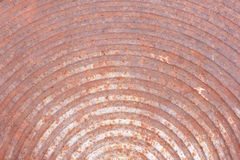 Manhole cover. Rusted manhole cover,curve line pattern Metal Texture royalty free stock image