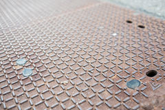 Manhole cover of steel with rust Royalty Free Stock Image