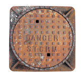 Manhole cover for storm drain isolated Royalty Free Stock Images