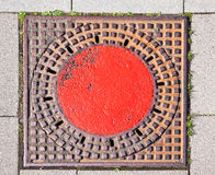 A manhole cover in the street to enter the canal Royalty Free Stock Images