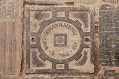 Manhole cover in Swayambhu, Kathnamdu, Nepal Royalty Free Stock Images
