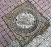 Manhole cover with the symbols of the National Academic Bolshoi Stock Photos