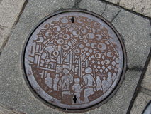 Manhole drain cover on the street in Taipei, Taiwan. stock images