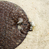 Manhole overflowing water in a rainy day Stock Image