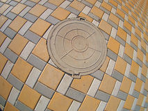 Manhole on the pavement. With wide angle fisheye view stock images