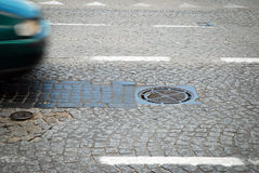 Manhole on the road Stock Photo