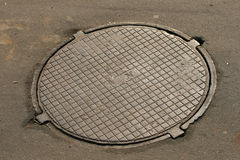 Manhole sewer cover Stock Photo