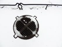 Manhole in the snow Stock Photos