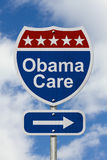 Manière d'obtenir le panneau routier de soin d'Obama Image libre de droits