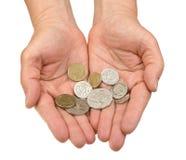 Mani 2 dei soldi Fotografia Stock