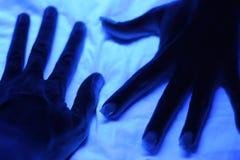 Mani al neon Fotografie Stock