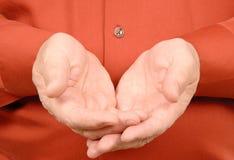 Mani allungate fuori Fotografia Stock