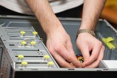 Mani in calcolatore Fotografia Stock