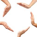 Mani che fanno un cerchio isolato Immagini Stock